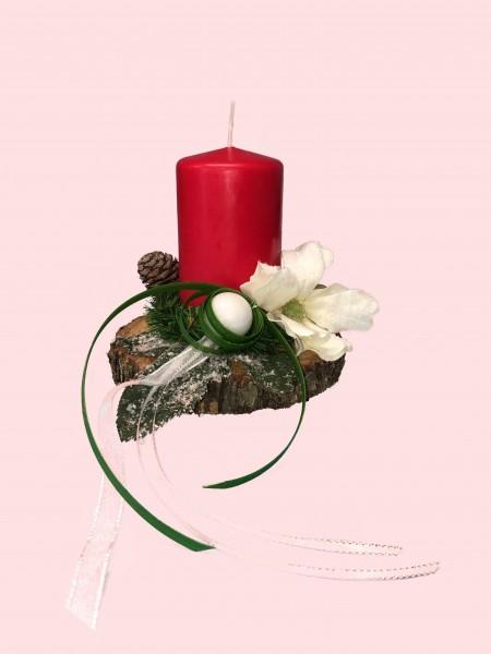 Adventsgesteck Nr.25 Baumscheibe mit roter Kerze und Magnolie